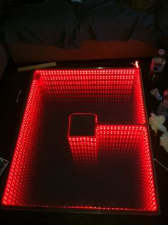 Just try not to get distracted by the infinity coffee table in the middle of the room.   21 Awesomely Geeky Household DIY Projects