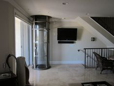 Here you can find some photos of the pneumatic vacuum elevators that we've installed in different homes all over the world!