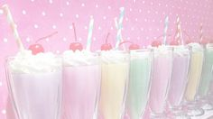 retro pastel rainbow milkshakes with whipped cream and a cherry!! (what flavour is green though...)