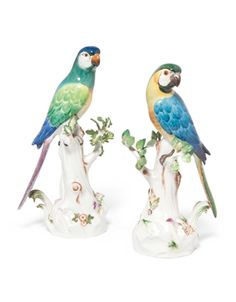 A pair of Meissen models of parrots circa 1924-34, blue crossed swords marks, incised  model no. 63 and 63X, Pressnummern 52 and 141