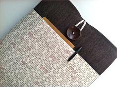 Padded iPad case with pocket.  Love the word fabric! - bertiescloset