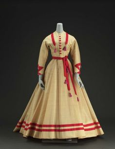 Day dress, ca. 1868. An interesting mix of red and pink tassles!