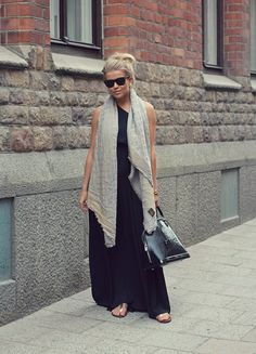 Blonde girl in black maxi dress, silver flat sandals, Louis Vuitton scarf & Louis Vuitton Alma bag