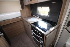 New and Used Motorhomes from Glossop Caravans Stacked Washer Dryer, Washer And Dryer, Used Motorhomes, Caravans, Swift, Home Appliances, Model, Image, House Appliances