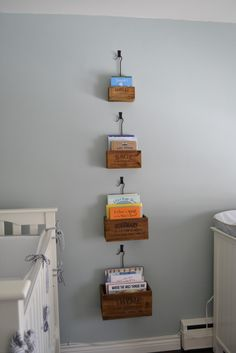 Love this idea for book storage in a kiddo's room. via: http://earningourstripes.blogspot.com/2012/07/nursery-before-after.html