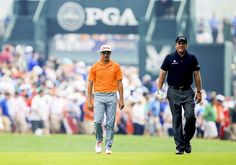 LOUISVILLE, KY - AUGUST 10: (L-R) Rickie Fowler of the United States and Phil Mickelson of the United States walk up the first fairway durin...