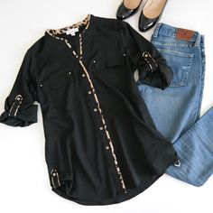 Calvin Klein Black Blouse with Leopard Accents A gorgeous black blouse with leopard trim accents. Gold buttons, roll-tab sleeves and polyester material. Two front pockets. Excellent condition! Calvin Klein Tops Blouses
