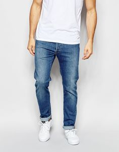 "Jeans by Edwin 11oz denim Mid-rise Button fly Relaxed tapered leg Leg opening: 36.2cm/14.25"" Tapered fit - cut loosely around the thigh and tapered from the knee to the ankle Machine wash 98.5% Cotton, 1.5% Elastane Our model wears a 81cm/32"" regular and is 183cm/6'0"" tall"