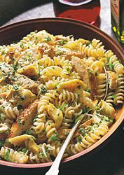 This healthy recipe is fast and easy to make! Food and wine's Grilled Chicken Pasta Salad With Artichoke Hearts, yum!