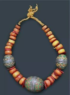 Morocco | Necklace; Silver and enamel Tagmout beads combined with amber, separated with felt washers | Tiznit | Est. 400-600€ (Feb '14)