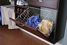 Keep dirty laundry and dry cleaning out of sight with a hidden clothes hamper. The basket easily lifts out for a trip to the laundry room.