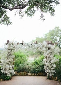 Ceremony Arbor: A fluffy display of baby's breath looks elegant as an addition to your ceremony arch.