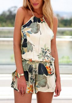 if you're looking for something new for your wardrobe, then this pastoral print crisscross cami romper is what you need.