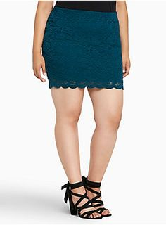 """<div>Trying to keep a low profile? Good luck in this mini (jaws will drop, heads will turn). Bold teal brightens up tried-and-true romantic lace. A thicker waistband is meant for tummy smoothing, and a tonal slip underlay provides coverage.</div><div><ul><li style=""""LIST-STYLE-POSITION: outside !important; LIST-STYLE-TYPE: disc !important"""">Size 1 measures 19"""" from center front</li><li style=""""LIST-STYLE-POSITION: outside !important; LIST-STYLE-TYPE: disc…"""