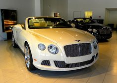 2013 Bentley Continental GTC V8 convertible...... Magnolia color custom from factory...... very well equipped for a mere $249,250. Has 4.0 liter V8 with 500 HP and 487 lb.-ft of torque.  All wheel drive, 20 or 21 inch custom wheels, 8-speed automatic with paddle shifters.  Top speed said to be 188 mph.