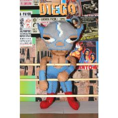 """Diego is a knitted Mexican wrestler soft toy, he's 12"""" tall and comes as a pdf download with knitting instructions and chart to make up."""