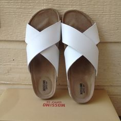 Women's 7 white sandals new without tags Women's size 7 white crisscross sandals. Never been worn. In great condition. New without tags's. Comes with original packaging. Has no damage. Mossimo Supply Co. Shoes Sandals