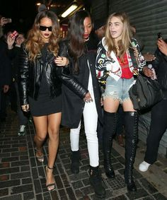 Cara Delevingne in thigh high combat boots and short-shorts