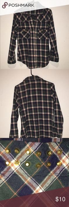 Unique, western style snap down flannel. Flirty and fun flannel with gold studs on front pockets. True snaps down the front of shirt. Awesome detailing on cuffs. Excellent condition. A beautiful piece. Arden B Tops Button Down Shirts