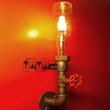 orig descrip: A wall lamp made from a beer bottle, plumbing pipe & fittings. Pipe Lighting, Cool Lighting, Plumbing Pipe, Plumbing Tools, Plumbing Fixtures, Bottle Lights, Pipe Lamp, Recycled Bottles, Pipe Furniture