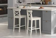 Image result for stornas table ingolf chairs in kitchen with gray cabinets and island with granite countertop