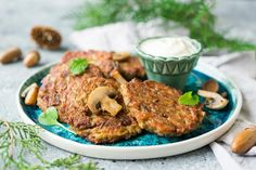 If you want to diversify your menu, try to make fragrant mushroom fritters, the recipes of which I will tell you today. To taste, they are no less tasty than meat or poultry fritters. Fresh or frozen mushrooms can be used for the recipe. Champignons, oyster mushrooms or forest mushrooms are suitable. Fritters with mushrooms can be fried in a frying pan or baked in the oven, so the dish will be less calorie. Mushroom fritters are very tasty, juicy and hearty, in addition to protein-rich…