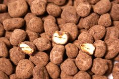 Quicos de Chocolate® - crunchy salted corn kernels dipped in chocolate and cocoa powder.