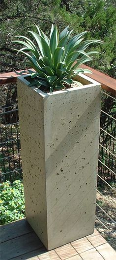 tall elongated square concrete planter on deck