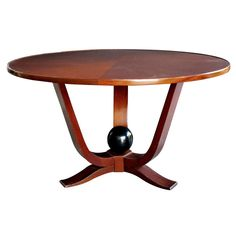 A Large-Scaled French Art Deco Mahogany Circular  Cocktail Table | From a unique collection of antique and modern coffee and cocktail tables at https://www.1stdibs.com/furniture/tables/coffee-tables-cocktail-tables/