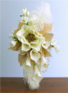 1920s Inspired Cascade Bridal Bouquet With Ivory Magnolias Freesia Calla Lilies And Gold