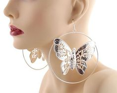 Ladies Silver 4.5 Inch Butterfly Drop Dangle Hoop Earrings Light Weight JOTW. $0.01. 100% Satisfaction Guaranteed!. The approximate measurements of the earrings measures 4.15 inches from top to bottom and 3.75 inch from left to right.. Great Quality Jewelry!