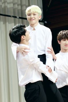 "Papa Jun holds their son Woozi as mama Hao stands there like ""don't drop him"""