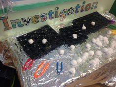 Fine motor fun- use the tweezers to put the 'snow balls' in the trays.