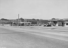 Hollywood Way, looking south, approaching Lockheed Air Terminal in 1944. Camouflage is visible on the roof of the plant. On the left is the Vega Plant which was the first plant to use fluorescent lighting. Sign for the Skyroom Cafe is on the left; the Terminal Drive-In is on the right. Coralie Hewitt Tillack Collection. San Fernando Valley History Digital Library.