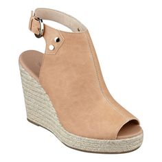 """Make sure you have the most awesome sandals of the season. Go ahead and show off a little leg with these fun platform wedge sandals. The sleek lines top an espadrille platform wedge with peep toe. Adjustable buckle closure. Padded footbed for all-day comfort. Leather upper. Man-made, lining and sole. Imported. 1"""" platform. 4 1/4"""" high wedge heels."""