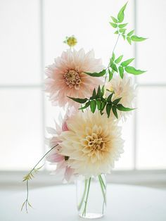 Gorgeous elegant yet simple centerpiece with pink and white dahlias