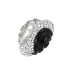 White Gold, Fluted Rock Crystal, Black Onyx and Diamond Ring  18 kt., centering a fancy-shaped bombe panel pave-set with 116 round diamonds approximately 3.50 cts., flanked by fluted rock crystal and fluted black onyx.