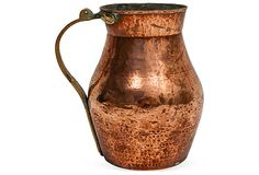 This antique copper pitcher has a pretty shape and lovely patina. Or do you prefer copper that is polished until it is bright & shiny?