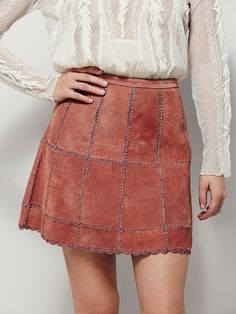 Piece Out Suede Mini Skirt   Luxe suede A-line mini skirt featuring patched suede with stitched embroidery detailing and a scalloped hem.  Button closure in back with a hidden zip.  Lined.  Wear with a pair of over-the-knee boots or a tuck-in shirt for an effortless look.