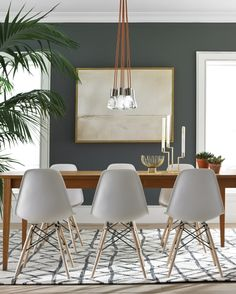 Super sleek dining, with Tech Lighting's Alva pendants.