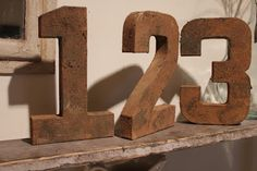 rusty looking paper mache letters