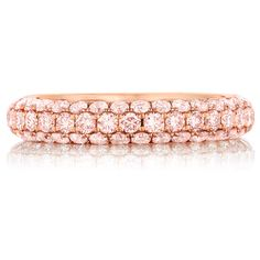 pink diamond and rose gold ring. I'd so prefer this over a typical wedding ring. I love just the simple diamond band. And I don't like silver, so basically this is perfect. :)