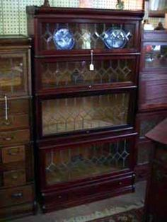 MAHOGANY GLOBE-WERNICKE STEP BACK 4 SECTION BARRISTER BOOKCASE WITH DRAW BASE CUSTOMIZED WITH SINGLE DIAMOND LEADED GLASS.