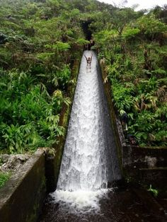 Ride this Hidden Flume Water Slide in Waipio Valley! Getting to the slide isn't easy, but you'll be happy you did it in  the end.  To get there head to the Flume Water Slide Trailhead at the end of White Road, just outside Waimea. You'll have to hike through steamy forests & pitch black tunnels and alongside hidden waterfalls and breathtaking views of Waipio Valley. You need permission to do the hike but it's worth the trouble when you get to visit this one of kind slide.