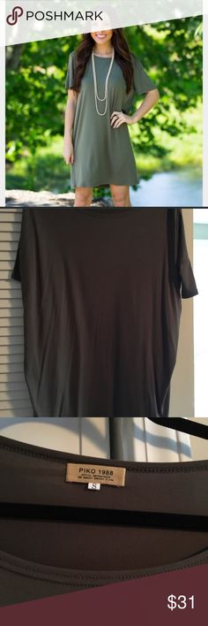 "PIKO T-Shirt Dress NWOT. Short sleeves.  Stock photo is the color I am selling.  The blue stock photo shows the fit of the sleeves.  Short sleeves that are fitted.  Pair with leggings or jeans.  Size small.  No flaws!!  Smoke free home. 33"" long according to PIKO size chart. Piko 1988 Dresses Mini"