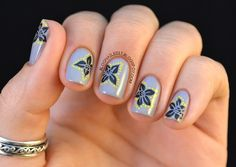 Hmmm... Dotting around a stamp. I like it!   From Nailed It.: Born Pretty M71 Plate Review