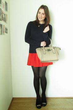 Shop this look on Lookastic:  http://lookastic.com/women/looks/ring-satchel-bag-skater-skirt-tights-ballerina-shoes-crew-neck-sweater/5939  — Gold Ring  — Beige Leather Satchel Bag  — Red Skater Skirt  — Black Wool Tights  — Black Leather Ballerina Shoes  — Black Crew-neck Sweater