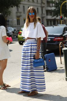 A cropped top and striped maxi skirt make for the perfect pairing on a sunny day.