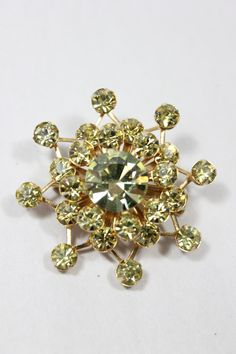 """Beautiful bling! This gold tone brooch features shimmering yellow rhinestones and pin back. Measures: 1½"""" round Circa: 1950's Condition: This product listing is for a used vintage item in excellent co"""