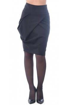 Stylish black skirt with straight cut. The skirt is long to the knee.